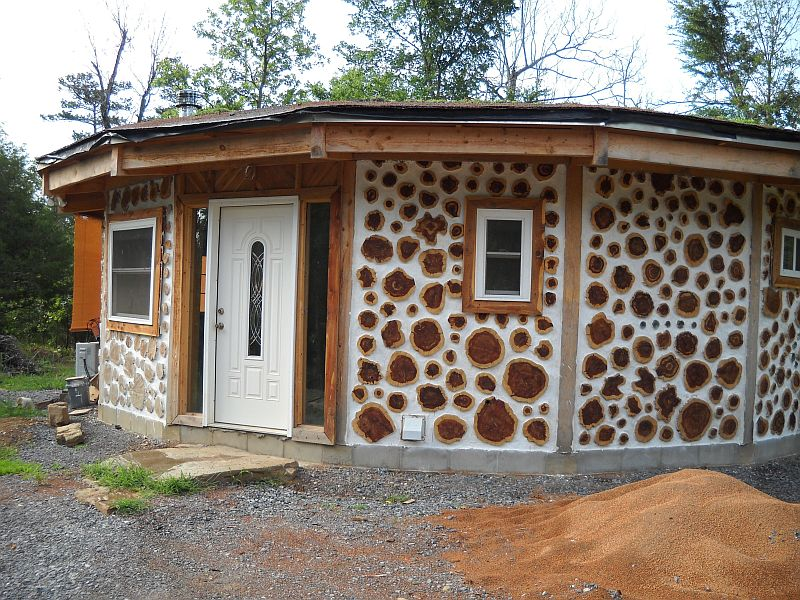 "Alan & Rebecca's 16 sided cordwood home-made of 12"" eastern red cedar."