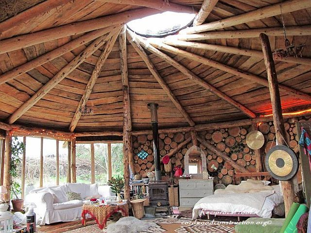 Reciprocal roof with cordwood and logo