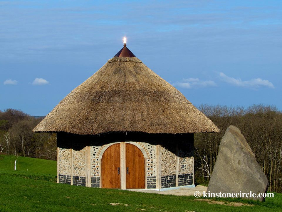 The sun has created an angel of light on the finial of the Kinstone Chapel  thatched, cordwood chapel is a beauty.jpg