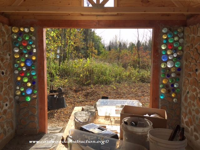 Cordwood Tool Shed w/Pitchfork