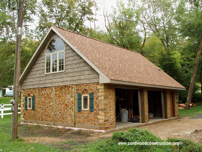 Two and a half card cordwood garage with living quarters upstaris Minnesota