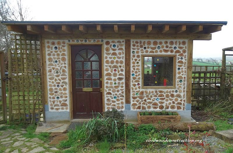 Tiny cordwood garden cottage in england cordwood for Cordwood house cost