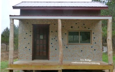 Tiny Off-Grid Cordwood Cabin with Straw-Clay is Timber Framed